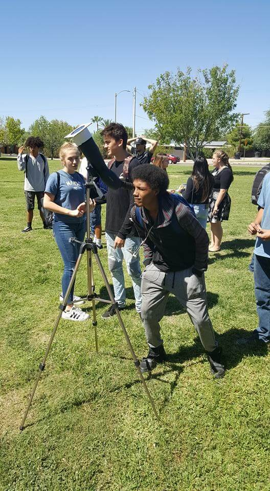 Students looking through telescope